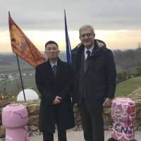 This 2018 photo provided on Jan. 3 by Italian Sen. Valentino Perin shows the senator (right) posing for a photo with then North Korean diplomat Jo Song Gil on the occasion of a cultural event with the Veneto region at a restaurant in San Pietro di Felletto, near Treviso, northern Italy. Italy's foreign minister said Wednesday that Italy is investigating whether the 17-year-old daughter of Jo was forcibly returned to Pyongyang as her parents apparently tried to defect. | VALENTINO PERIN / VIA AP