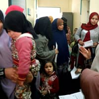A family planning adviser speaks with Egyptian mothers at a new clinic in the province of Fayoum, southwest of Cairo, Tuesday.l | REUTERS