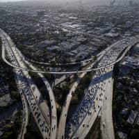 Vehicles sit in rush-hour traffic between the Interstate 405 and 10 freeways in Los Angeles. | BLOOMBERG