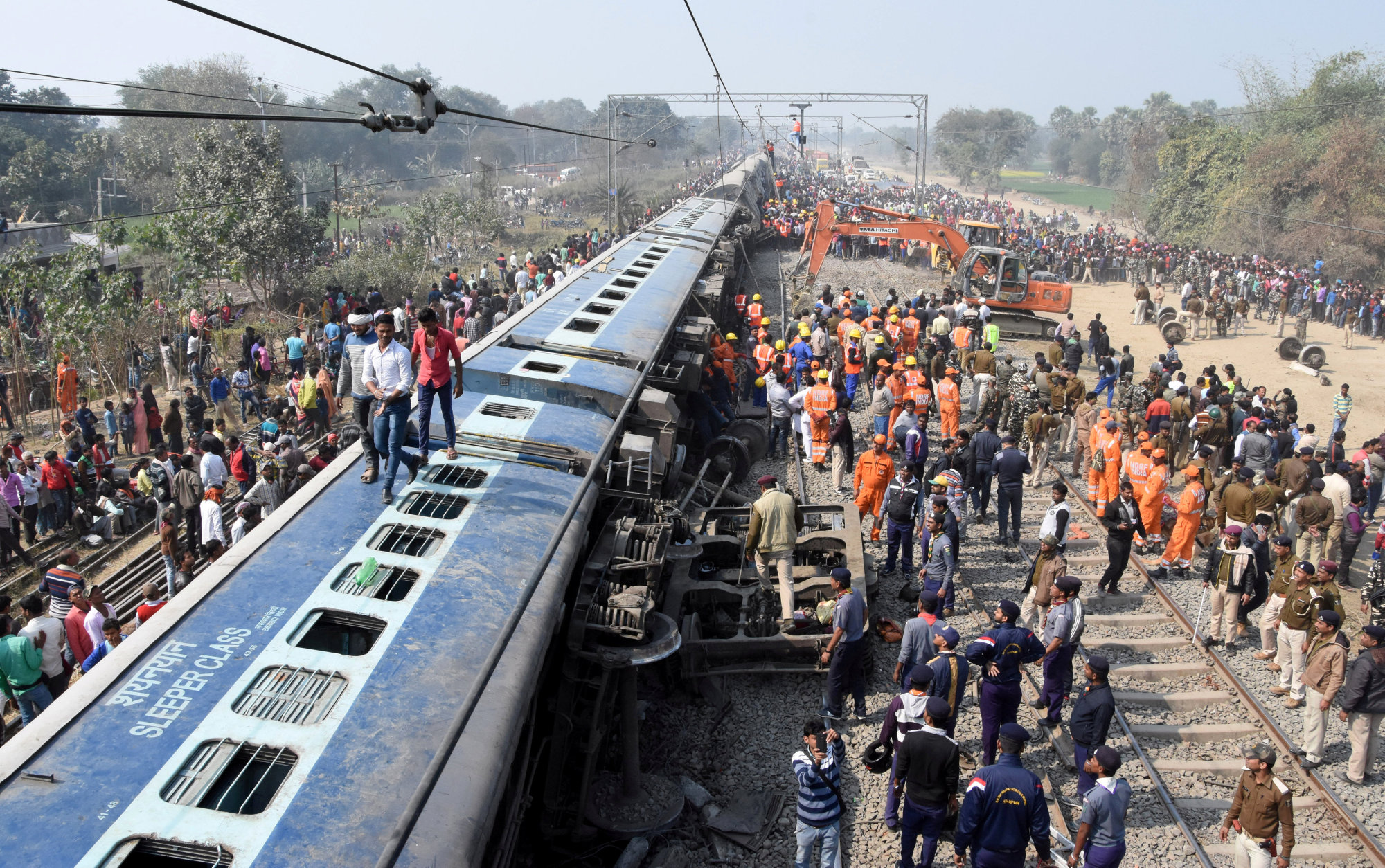 Rescue workers look for survivors after a passenger train derailed near Sahadai Buzurg railway station in the eastern state of Bihar, India, Sunday. | REUTERS