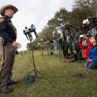 Chambers County Sheriff Brian Hawthorne gives an update on a plane crash in Trinity Bay during a news conference in Anahuac, Texas, Saturday. A Boeing 767 cargo jetliner heading to Houston with a few people aboard disintegrated after crashing Saturday into the bay east of the city. | BRETT COOMER / HOUSTON CHRONICLE / VIA AP
