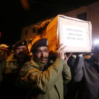 Indian police carry the coffin containing the body of their fallen colleague, who according to police was killed in a gunbattle between suspected militants and security forces in south Kashmir's Pulwama district, during his wreath-laying ceremony in Srinagar, India, Monday. | REUTERS