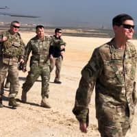 U.S. Army Gen. Jospeh Votel, head of Central Command, visits an airbase at an undisclosed location in northeast Syria Monday. | REUTERS