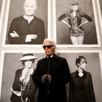 Chanel's creative director Karl Lagerfeld poses before the opening of his photo exhibition entitled 'Little Black Jacket' at the Grand Palais in Paris on Nov. 8, 2012. The fashion icon died at age 85, Chanel announced Tuesday. | REUTERS