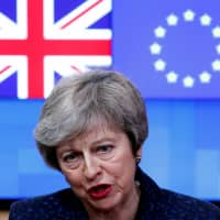 British Prime Minister Theresa May speaks to the press at the European Council headquarters in Brussels, Belgium, on Thursday.   REUTERS