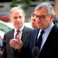 Peter Flaherty (left), chairman of the National Legal and Policy Center (NLPC), and Paul Kamenar (right), attorney for Roger Stone's associate, Andrew Miller, speak to reporters outside U.S. District Court to explain Miller's refusal to appear before a grand jury in special counsel Robert Mueller's probe in Washington last August. | REUTERS