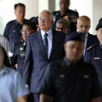 Malaysia delays ex-leader Najib Razak's first trial for 1MDB-linked charges