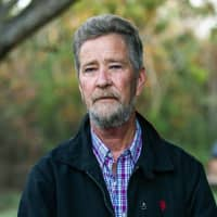 Leslie McCrae Dowless Jr. poses for a portrait outside of his home in Bladenboro, North Carolina, in December. The Republican in the nation's last undecided congressional election said Monday he recruited Dowless, a political operative now at the center of a ballot fraud investigation, because he produced election results in his rural North Carolina county and other Republicans vouched for him. | TRAVIS LONG / THE NEWS