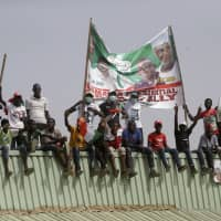 Supporters of Nigerian presidential candidate Atiku Abubakar, of the People's Democratic Party, attend an election campaign rally on the street in Yola, Nigeria, Thursday. Nigeria goes to the polls on Saturday to elect a new president.   AP