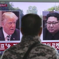 A TV in Seoul Station broadcasts news of the upcoming summit between U.S. President Donald Trump and North Korean leader Kim Jong Un. | AP