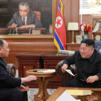 North Korean leader Kim Jong Un meets with a delegation that visited the United States, in Pyongyang, in this photo released on Jan. 23. | REUTERS