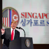 U.S. President Donald Trump speaks during a news conference following his summit with North Korean leader Kim Jong Un in Singapore on June 12. | BLOOMBERG