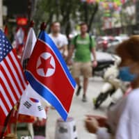 U.S. and North Korean flags are on display for sale at a shop in Hanoi on Jan. 29.   AP