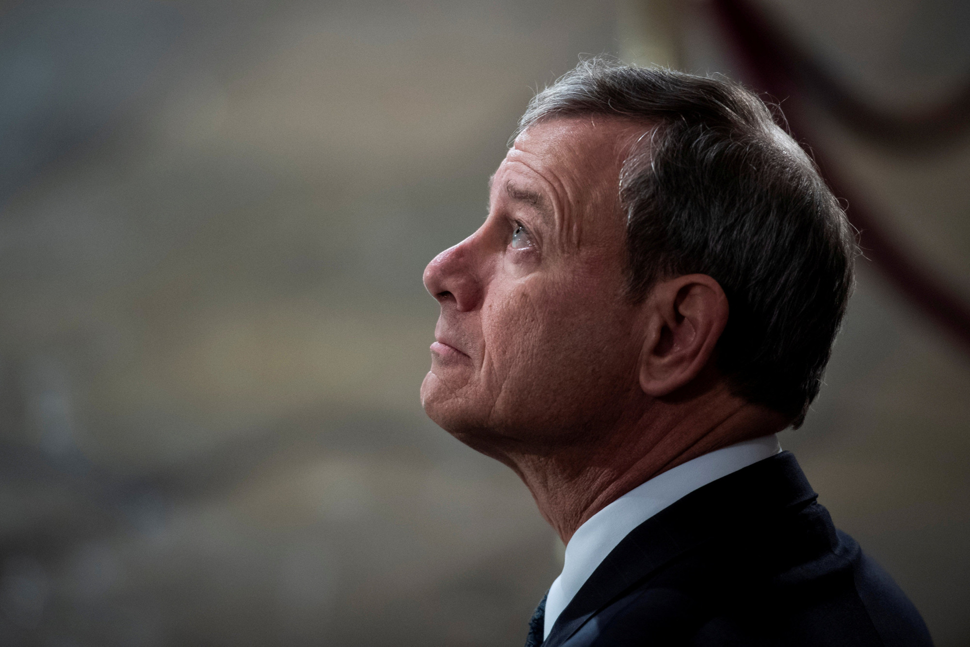 Supreme Court Chief Justice John G. Roberts waits for the arrival of former President George H.W. Bush to lie in state at the U.S. Capitol Rotunda on Dec. 3. | POOL / VIA REUTERS