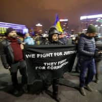 Thousands of Romanians protest judicial changes after decree pares independence of prosecutors