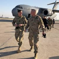 U.S. Army Gen. Joseph Votel (left), head of the U.S. military's Central Command, walks with U.S. Army Lt. Gen. Paul LaCamera commander of the U.S.-led coalition against Islamic State, after landing in Baghdad Sunday. | REUTERS