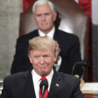 U.S. President Donald Trump delivers his State of the Union address on Tuesday to a joint session of Congress in Washington as Vice President Mike Pence watches. | AP