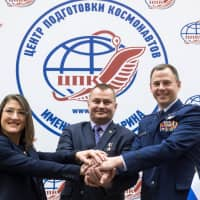 Members of the International Space Station expedition 59/60 (from left) NASA astronauts Christina Hammock Koch and Nick Hague and Russian cosmonaut Alexey Ovchinin pose during a press conference at the Gagarin Cosmonauts' Training Centre in Star City outside Moscow on Thursday. The trio are preparing for the launch onboard the Soyuz MS-12 spacecraft from the Russian-leased Kazakh Baikonur cosmodrome on March 14. | AFP-JIJI