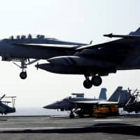 A U.S. Navy F18 fighter jet lands on the deck of aircraft carrier USS Carl Vinson during a routine exercise in the South China Sea in 2017. | REUTERS