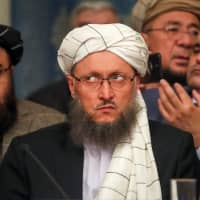 Abdul Salam Hanafi, the deputy head of the political office for the Taliban, attends a conference arranged by the Afghan diaspora in Moscow on Tuesday. | REUTERS