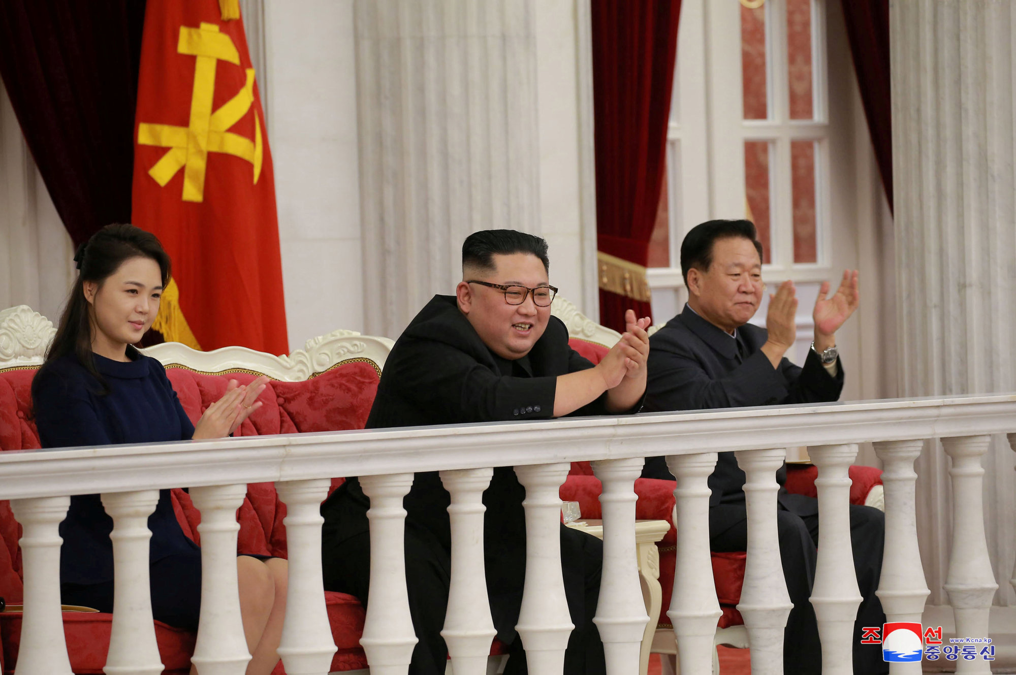 North Korean leader Kim Jong Un and wife Ri Sol Ju applaud during a performance by the State Merited Chorus at an annex to the headquarters of the Party Central Committee on the 71st founding anniversary of the Korean People's Army (KPA), in Pyongyang Feb. 8. | KCNA / VIA REUTERS