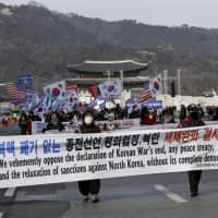 Protesters march during a rally supporting the United States' policy to put steady pressure on North Korea, in Seoul Saturday. | AP