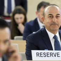 Turkish Foreign Minister Mevlut Cavusoglu attends the High-Level Segment of the 40th session of the Human Rights Council, at the European headquarters of the United Nations in Geneva on Monday. | SALVATORE DI NOLFI / KEYSTONE / VIA AP