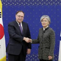 South Korean Foreign Minister Kang Kyung-wha and Timothy Betts, acting Deputy Assistant Secretary and Senior Advisor for Security Negotiations and Agreements at the U.S. Department of State, shake hands before their meeting at Foreign Ministry in Seoul on Sunday. | POOL / VIA REUTERS