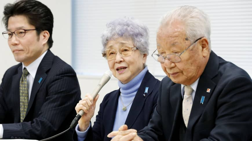 Sakie Yokota (center) speaks during a news conference in Tokyo on Sunday, along with Shigeo Iizuka (right), the head of a group of families of Japanese nationals abducted to North Korea.
