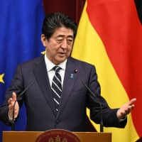 Prime Minister Shinzo Abe speaks during a news conference at his official residence in Tokyo on Monday. | BLOOMBERG