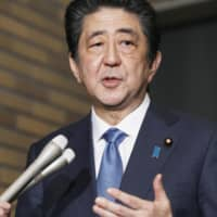 Prime Minister Shinzo Abe speaks to reporters at his official residence in Tokyo on Wednesday night after a call with U.S. President Donald Trump. | KYODO