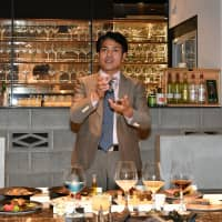 Mikio Atobe showcases dishes he plans to serve at his restaurant in Ginza, including fermented food products and dry aged beef and fish made with aging sheets, on Feb. 18. | YOSHIAKI MIURA