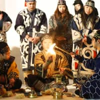 The sacred torch for the 2017 Asian Winter Games is ignited in Sapporo on Feb. 5, 2017, using a traditional fire-starting method used by the Ainu people, before being lit in the cauldron during the opening ceremony there later that month.