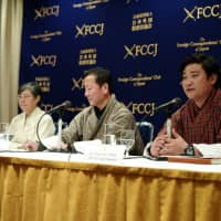 From left, Yumiko Kan of Nature and Humans Japan and Sonam Dhendup and Nagwang Tobgay, of the Parent's Committee of the Learn and Earn Program, attend a news conference Monday at the Foreign Correspondents' Club of Japan in Tokyo. | RYUSEI TAKAHASHI