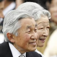 Emperor Akihito and Empress Michiko greet guests at the autumn garden party in Tokyo in November 2014. | AP