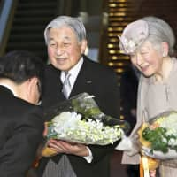 Emperor Akihito and Empress Michiko wrap up a ceremony Sunday in Tokyo at the National Theatre of Japan, marking 30 years of his reign. | KYODO