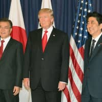 South Korean President Moon Jae-in, U.S. President Donald Trump and Prime Minister Shinzo Abe meet on the sidelines of a Group of 20 gathering in Hamburg, Germany, in July 2017. | KYODO