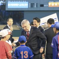 International Olympic Committee President Thomas Bach (center) and Prime Minister Shinzo Abe are pictured during their visit to Azuma Baseball Stadium in Fukushima on Nov. 24 last year. | POOL / VIA KYODO
