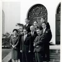 Donald Keene (front center), upon receiving the Kikuchi Kan Prize in 1962, poses for a photo with Haru Reischauer (front left), wife of U.S. Ambassador to Japan Edwin Reischauer (third row, left), author Yukio Mishima (second row, right) and others in front of the U.S. Ambassador's Residence in Tokyo. | COURTESY OF DONALD KEENE