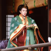 Princess Masako, wearing a traditional junihitoe (12-layer robe) kimono, walks the corridor at the Imperial Palace after her wedding ceremony on June 9, 1993. | POOL / VIA KYODO