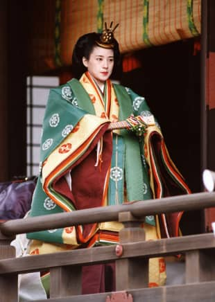 Princess Masako, wearing a traditional junihitoe (12-layer robe) kimono, walks the corridor at the Imperial Palace after her wedding ceremony on June 9, 1993.