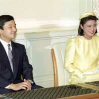 Crown Prince Naruhito and his then-fiancee, Masako Owada, speak during a news conference after the Imperial Household Council approved their engagement, on Jan. 19, 1993, in Tokyo. | KYODO