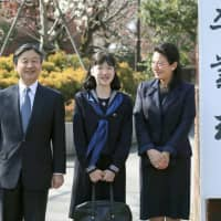 Crown Princess Masako poses along with Crown Prince Naruhito and Princess Aiko at their daughter's graduation ceremony at Gakushuin Girls' Junior High School on March 22, 2017. | POOL / VIA KYODO