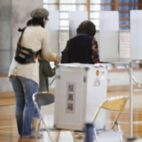 Citizens in Okinawa Prefecture vote in a referendum on the relocation plan for U.S. Marine Corps Air Station Futenma at a polling station in Naha on Sunday. | KYODO