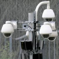 """Surveillance cameras are installed at the Olympic Park in London ahead of the London Games in July 2012.   ‹?""""¯"""