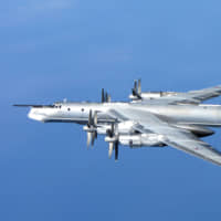 A Russian Tupolev Tu-95 is photographed from a British Royal Air Force Typhoon quick reaction alert aircraft after the Russian bomber approached the NATO Air Policing Area north of Scotland in April 2014. | RAF