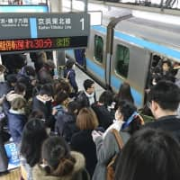 Delays continued Wednesday morning at Nishikawaguchi Station in Saitama Prefecture after services were restored following an accident on the Shonan Shinjuku Line. | KYODO