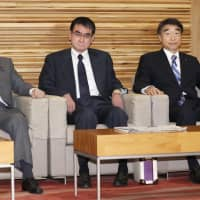 Foreign Minister Taro Kono (center) attends a Cabinet meeting last week in Tokyo.   KYODO