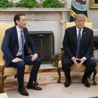 U.S. President Donald Trump and Sebastian Kurz, Austria's chancellor (left), meet in the Oval Office of the White House in Washington Wednesday. | CHRIS KLEPONIS / POOL / VIA BLOOMBERG