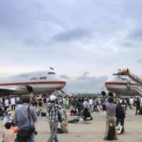 Government jets for the prime minister and Imperial family are displayed for public viewing at Chitose air base in Hokkaido last July. The planes are set to be decommissioned in March.   KYODO